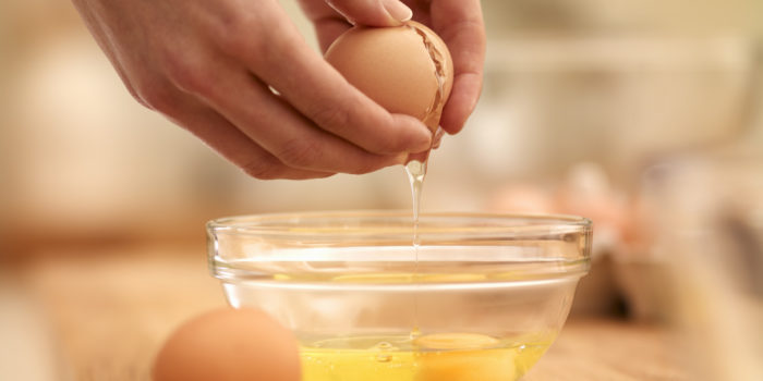 Woman cracking egg